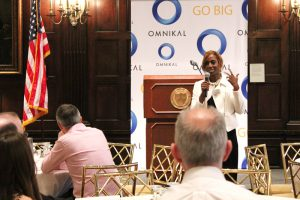 Bisila Bokoko, Founder and CEO of BBES presenting keynote address at the OMNIKAL business summit.