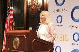 Honorary Chair, Carmen Castillo, President & CEO at SDI International Corp kicking off OMNIKAL 17th Annual National Business Summit.