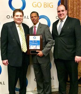 Nicholas Lananna, Client Service Manager at Omega World Travel; Gregory George, Regional Sales Manager at Omega World Travel and Kenton Clarke, President & CEO at OMNIKAL